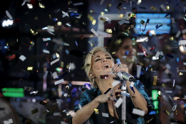 Singer Carrie Underwood performs on the main stage in Times Square during New Year's Eve celebrations in the Manhattan borough of New York, December 31, 2015. (Photo by Carlo Allegri/Reuters)