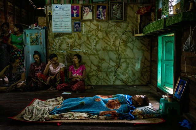 The body of Kyaw Htet Aung, 19, who was shot and killed in the night by the security forces, lies at his home during his funeral in Dala township on March 27, 2021 in Yangon, Myanmar. Myanmar's military Junta continued a brutal crackdown on a nationwide civil disobedience movement in which thousands of people have turned out in continued defiance of live ammunition. Local news sources and witnesses said over 90 protesters were killed on Saturday, the deadliest day of clashes since protests against the coup began. (Photo by Stringer/Getty Images)