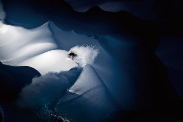 """An image of a snowboarder on the Tordillo Mountains in the USA won Scott Servas the """"Illumination"""" category. (Photo by Scott Servas/Red Bull)"""