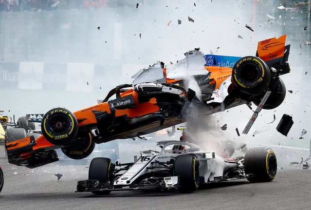 Mclaren driver Fernando Alonso of Spain, top, goes over the top of Sauber driver Charles Leclerc of Monaco as they are involved in a crash at the start of the Belgian Formula One Grand Prix in Spa-Francorchamps, Belgium, Sunday, August 26, 2018. (Photo by Francois Lenoir/Reuters)