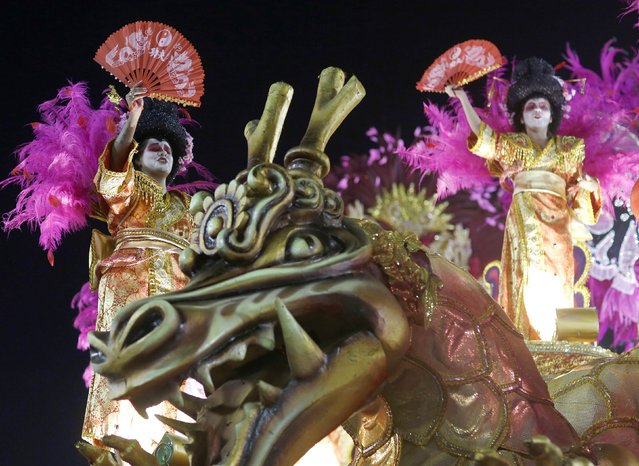 Revellers from the Vila Isabel samba school participate in the annual carnival parade in Rio de Janeiro's Sambadrome, February 16, 2015. (Photo by Pilar Olivares/Reuters)