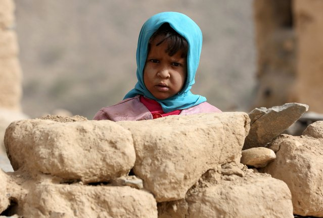 A girl looks as she stands outside her home in Al Khurais village of Nihm district east of the capital Sanaa January 11, 2016. (Photo by Ali Owidha/Reuters)