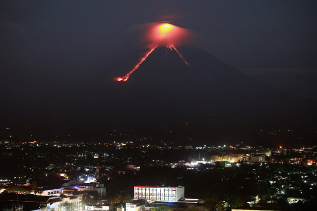 Lava from Mayon volcano is seen as it erupts in Legazpi on January 15, 2018. The Philippines raised the alert level for the country's most active volcano twice in 24 hours on January 14, meaning that a hazardous eruption is possible within days. (Photo by Charism Sayat/AFP Photo)