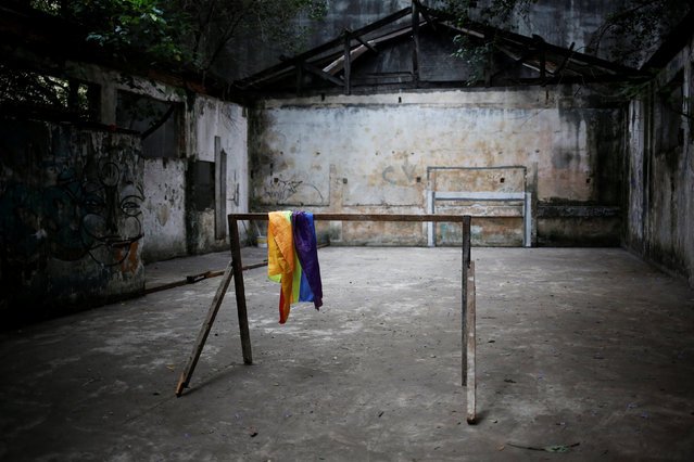 A rainbow flag is seen inside a building where members of the roofless movement have recently been joined by lesbian, gay, bisexual and transgender people seeking refuge from discrimination and hate crimes, in downtown Sao Paul, Brazil, November 26, 2016. (Photo by Nacho Doce/Reuters)