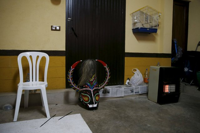 The mask of the Jarramplas, a character who wears a colourful costume as he makes his way through the streets while beating his drum, rests on the floor before being used by Armando Vicente Vicente (not pictured) during the Jarramplas traditional festival in Piornal, southwestern Spain, January 20, 2016. (Photo by Susana Vera/Reuters)