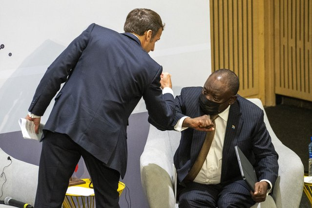 French President Emmanuel Macron is congratulated by South African President Cyril Ramaphosa after giving a speech at the University of Pretoria Future Africa in Pretoria, South Africa, Friday May 28, 2021. Macron Ramaphosa are launching a program to support African vaccine production, a project backed by the European Union, the United States and the World Bank. (Photo by Jerome Delay/AP Photo)
