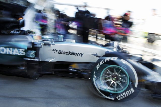 Mercedes Formula One driver Lewis Hamilton of Britain exits the team garage during the first practice session of the Australian F1 Grand Prix at the Albert Park circuit in Melbourne March 13, 2015.  REUTERS/Brandon Malone