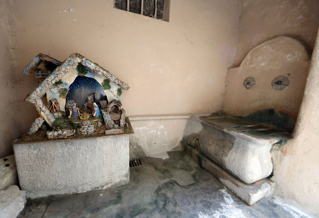 A Nativity scene is seen at a lavoir (wash-house), a traditional public place for the washing of clothes, in the medieval mountain village of Luceram as part of Christmas holiday season, France, December 15, 2016. (Photo by Eric Gaillard/Reuters)