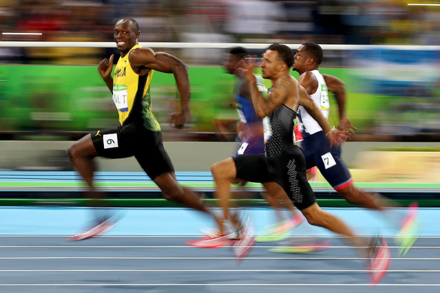 Silver Award. The Smile (2016). Usain Bolt of Jamaica competes in the men's 100m semi-final at the Rio Olympics. (Photo by Cameron Spencer/World Sports Photography Awards 2021)