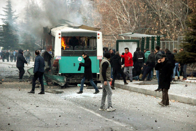 People react after a bus was hit by an explosion in Kayseri, Turkey, December 17, 2016. (Photo by Turan Bulut/Reuters/Ihlas News Agency)
