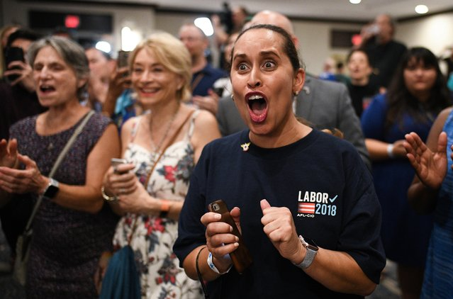 Supporters of Sen. Bill Nelson (D-FL) react during an election night event at the Embassy Suites on November 6, 2018 in Orlando, Florida. Nelson is running against Republican Governor of Florida Rick Scott for the Florida Senate seat. (Photo by Jeff J. Mitchell/Getty Images)