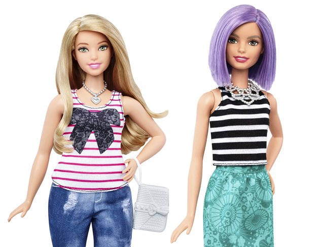 The new curvy Barbie doll body shape (L) is seen next to the traditional Barbie in a combination of photos released by Mattel on January 28, 2016. Barbie, the world's most famous doll, has a new body. In fact, she has three new bodies – petite, tall and curvy. Some 57 years after the impossibly busty and narrow-waisted blue-eyed Barbie doll was first introduced, California-based toy maker Mattel on Thursday released the new models, which it says better reflect a changing world. (Photo by Reuters/Mattel)