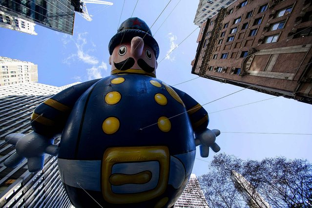 A Keystone Cop balloon floats down Sixth Avenue. (Photo by Eric Thayer/Reuters)