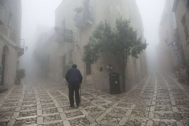 """""""The fork"""". An elderly man is seen while walking the streets of Erice in Sicily. Photo location: Erice, Sicily. (Photo and caption by Giorgio Bianchi/National Geographic Photo Contest)"""