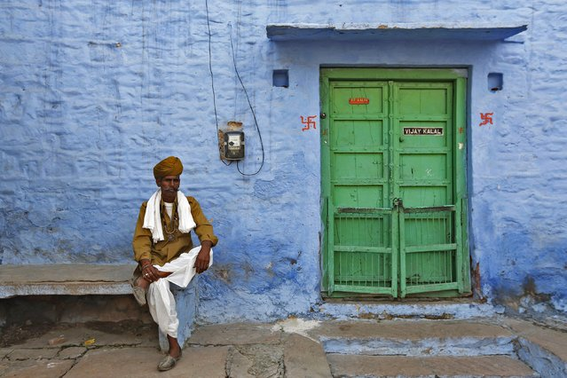 A man poses for a picture outside his house at Jodhpur in Rajasthan, April 7, 2015. (Photo by Adnan Abidi/Reuters)