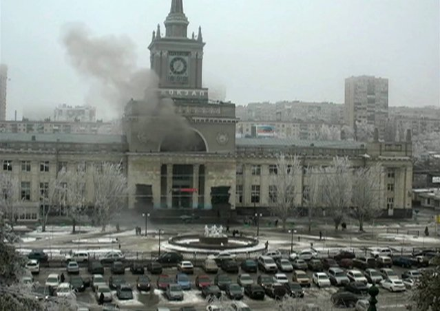In this photo made by a public camera and made available by the Associated Press Television News  smoke pours out  after an explosion at Volgograd railway station, in Volograd Russia on Sunday, December 29, 2013. (Photo by AP Photo/ Associated Press Television News)
