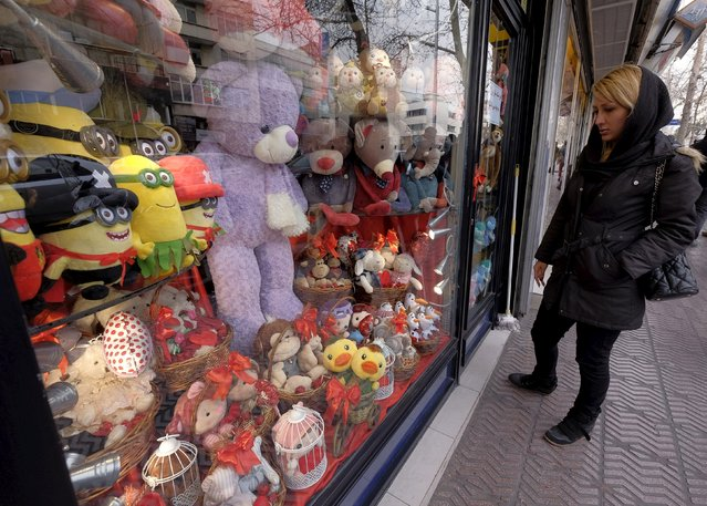 Iranian woman looks for Valentine's day gifts at a shop in Tehran, Iran, February 14, 2016. (Photo by Raheb Homavandi/Reuters/TIMA)