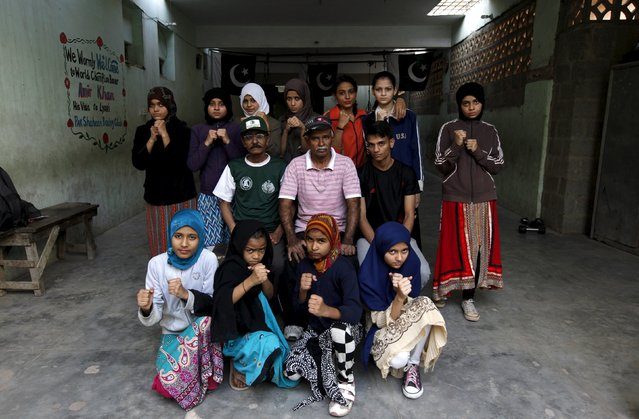 Girl trainees pose for a group photograph with their coach Yunus Qambrani and assistant coach Nadir at the first women's boxing coaching camp in Karachi, Pakistan February 20, 2016. (Photo by Akhtar Soomro/Reuters)