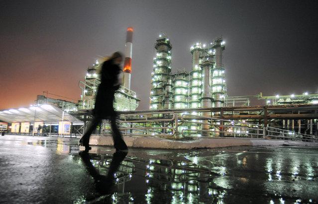 A man walks in front of the Novokuibyshevsk refinery near the city of Samara, Russia on October 28, 2010. (Photo by Nikolay Korchekov/Reuters)
