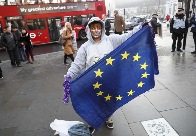A man holds a European Union flag outside the Supreme Court before the decision of a court ruling on whether Theresa May's government requires parliamentary approval to start the process of leaving the European Union, in Parliament Square, central London, Britain, January 24, 2017. (Photo by Stefan Wermuth/Reuters)