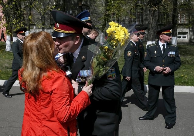 A Ukrainian army officer kisses his wife after a graduation ceremony at the National University of Defence of Ukraine in Kiev, Ukraine April 24, 2015. (Photo by Gleb Garanich/Reuters)