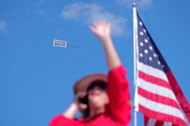 A biplane pulling a pro-Biden message flies above a rally attended by former U.S. President Donald Trump in Perry, Georgia, U.S. September 25, 2021. (Photo by Dustin Chambers/Reuters)