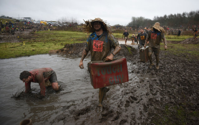 """Competitors take part in the """"Tough Guy"""" adventure race near Wolverhampton, central England, on January 29, 2017. (Photo by Oli Scarff/AFP Photo)"""