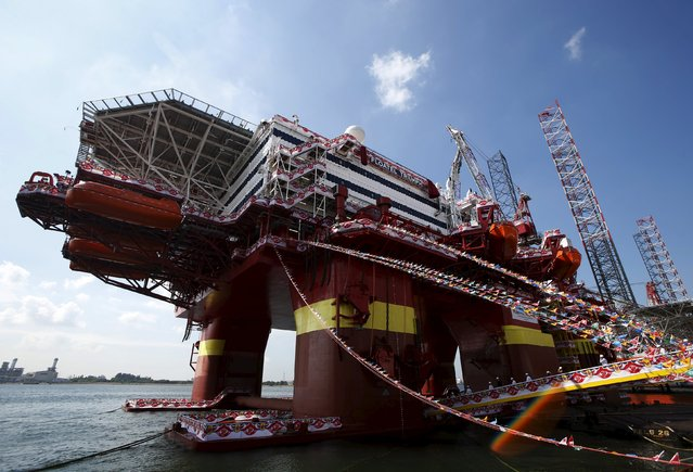 Visitors walk onto Floatel Triumph during a Keppel FELS delivery ceremony of the semi-submersible accommodation rig to Floatel at their shipyard in Singapore March 11, 2016. (Photo by Edgar Su/Reuters)