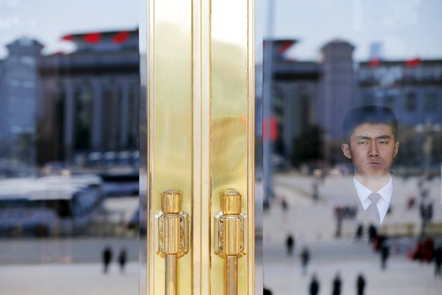 A security officer stands guard at the Great Hall of the People during the third plenary session of the National People's Congress (NPC), in Beijing, China, March 13, 2016. (Photo by Damir Sagolj/Reuters)