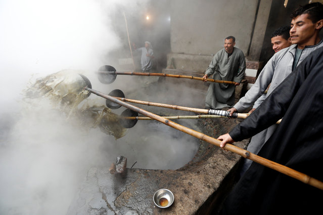 "Workers cook ""black honey"" molasses, made from sugarcane, at a small factory in Mallawi, Minya governorate, south of Cairo, Egypt February 3, 2019. (Photo by Amr Abdallah Dalsh/Reuters)"