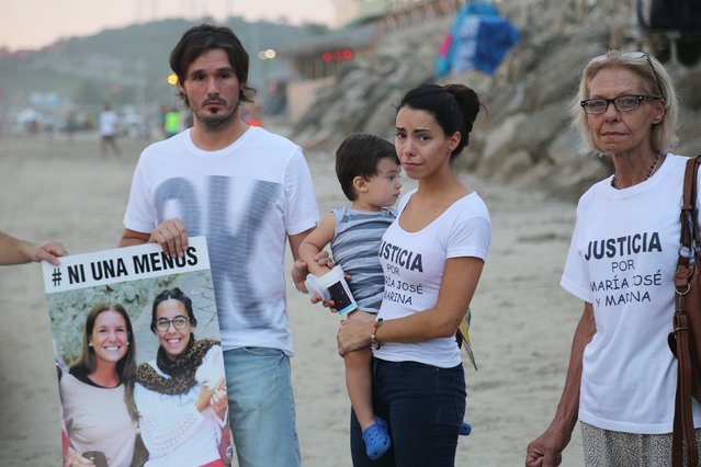 Relatives of Argentinian tourist Maria Jose Coni, who was killed in February in Ecuador alongside Marina Menegazzo, stand in silence facing the sea as a tribute, in Montanita, Ecuador March 18, 2016. Argentine experts confirmed Wednesday that two bodies found in the popular Ecuadorean beach resort Montañita belong to Argentine tourists, Marina Menegazzo and Maria Jose Coni. The deaths of the two backpackers, aged 21 and 22, has sparked debate across Ecuador and Latin America, with some pointing out the victim-blaming culture of the region. (Photo by Manuel Soriano/Reuters)