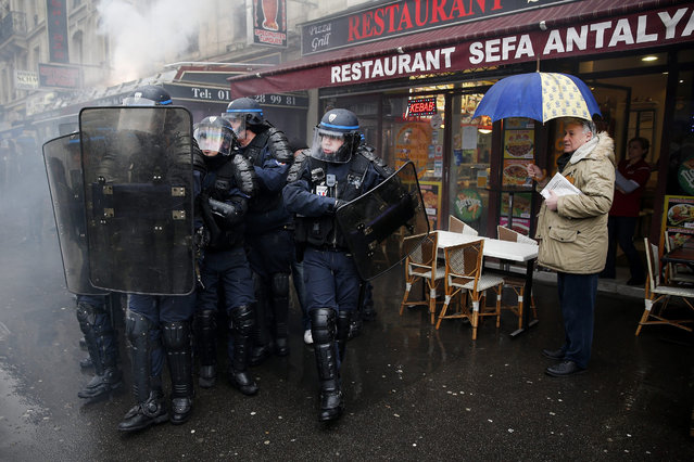 French police clash with demonstrators during a protest against the labor law reform bill in Paris on March 31. French students and work unions took to the streets to protest against a draft of a labor reform law led by French Labor Minister Myriam El Khomri. (Photo by Yoan Valat/EPA)