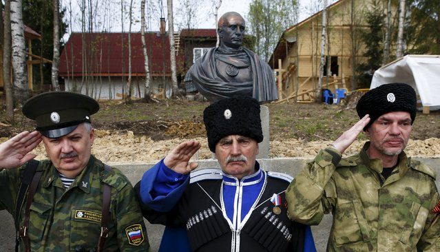 Cossacks salute during an unveiling ceremony for a bust of Russian President Vladimir Putin which depicts him as a Roman emperor, in Leningrad region, Russia, May 16, 2015. (Photo by Maxim Zmeyev/Reuters)