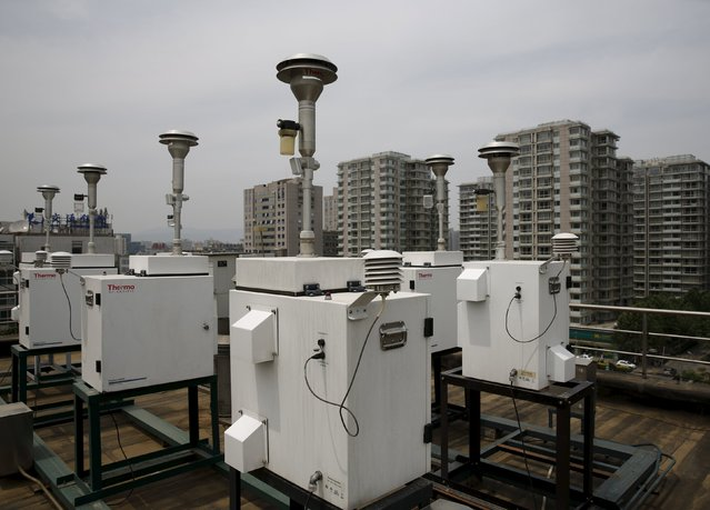 Devices for collecting samples of Beijing's air are installed on the rooftop of the air quality forecast and warning center in Beijing, China, May 21, 2015. (Photo by Kim Kyung-Hoon/Reuters)