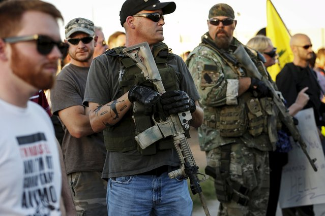 """Men carrying rifles attend a """"Freedom of Speech Rally Round II"""" across from the Islamic Community Center in Phoenix, Arizona May 29, 2015. More than 200 protesters, some armed, berated Islam and its Prophet Mohammed outside an Arizona mosque on Friday in a provocative protest that was denounced by counterprotesters shouting """"Go home, Nazis,"""" weeks after an anti-Muslim event in Texas came under attack by two gunmen.     REUTERS/Nancy Wiechec"""