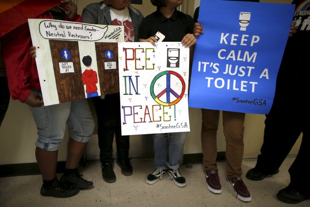 Students holds signs they made to campaign for the first gender-neutral restroom in the Los Angeles school district at Santee Education Complex high school in Los Angeles, California, U.S., April 18, 2016. (Photo by Lucy Nicholson/Reuters)