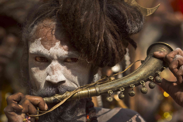 An Indian Sadhu, or Hindu holy man, plays a traditional musical instrument at the Kamakhya Hindu temple ahead of the Ambubachi festival in Gauhati, India, Friday, June 21, 2019. The festival is held in celebration of the annual menstrual cycle of the Goddess Shakti at the Kamakhya Temple. The four-day festival will begin Saturday. (Photo by Anupam Nath/AP Photo)