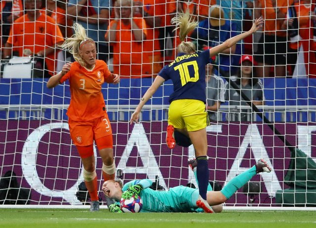 Sweden's forward Sofia Jakobsson (R) vies with Netherlands' goalkeeper Sari van Veenendaal (2ndR) during the France 2019 Women's World Cup semi-final football match between the Netherlands and Sweden, on July 3, 2019, at the Lyon Stadium in Decines-Charpieu, central-eastern France. (Photo by Denis Balibouse/Reuters)