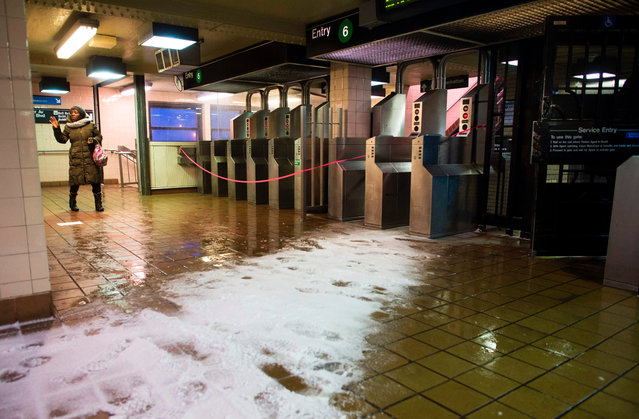 A woman arrives at a closed subway station that services an above ground train in the Bronx Borough March 14, 2017 in New York. (Photo by Don Emmert/AFP Photo)