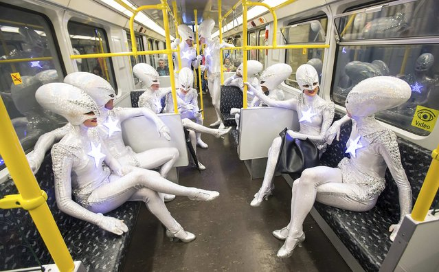 "Dancers of the Friedrichstadt-Palast from the show ""THE WYLD"" pose during a promotional photocall in the carriage of an underground train in Berlin, Germany, June 23, 2015. (Photo by Hannibal Hanschke/Reuters)"