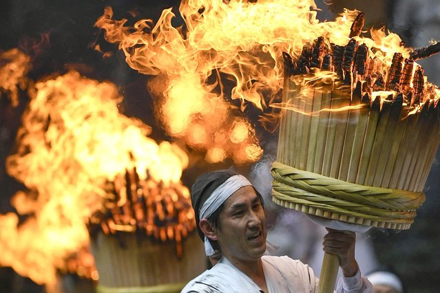 An annual fire festival is held in Nachikatsuura, Wakayama Prefecture, western Japan, on July 14, 2019. (Photo by Kyodo News via Getty Images)