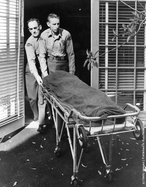 Medical attendents removing the body of Marilyn Monroe (Norma Jean Mortenson or Norma Jean Baker, 1926 - 1962) from her home