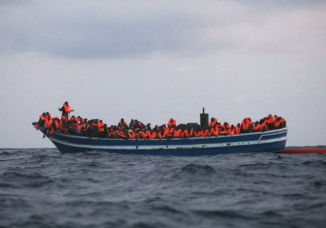 Over 400 migrants are seen overcrowding a wooden vessel drifting in central Mediterranean Sea off the Libyan coast, March 29, 2017 during a search and rescue operation by Spanish NGO Proactiva Open Arms. (Photo by Yannis Behrakis/Reuters)