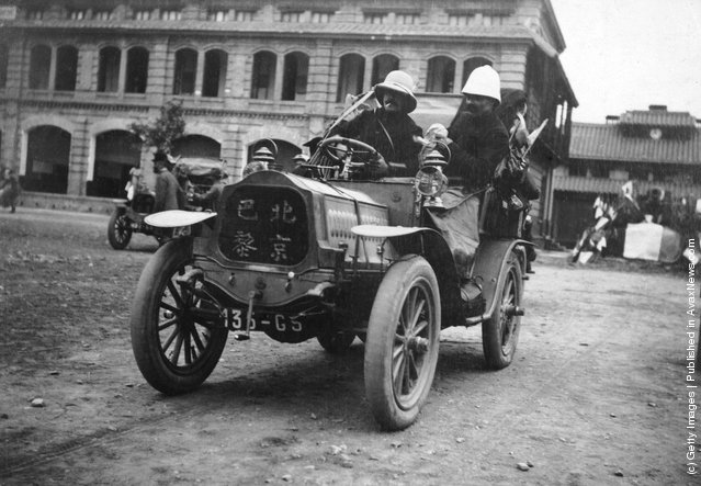 1909: An entrant in the Peking (Beijing) to Paris motor race arrives at the start of the race in a De Dion Bouton
