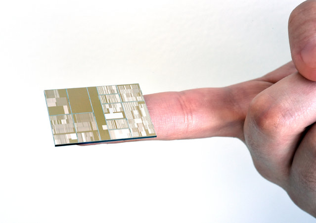 "This July 2, 2015 photo provided by IBM shows a 7 nanometer chip produced at SUNY Poly Colleges of Nanoscale Science and Engineering (CNSE) in Albany, NY. IBM says it has achieved a breakthrough in shrinking computer chips, creating a test version of the world's first semiconductor that shrinks down the circuitry by overcoming what's been ""one of the grand challenges"" of the industry. (Photo by Darryl Bautista/Feature Photo Service for IBM via AP Photo)"