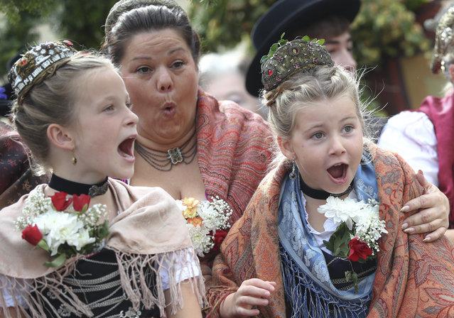 "Children scream during the Oktoberfest parade, at the 186th ""Oktoberfest"" beer festival in Munich, Germany, Sunday, September 22, 2019. (Photo by Matthias Schrader/AP Photo)"
