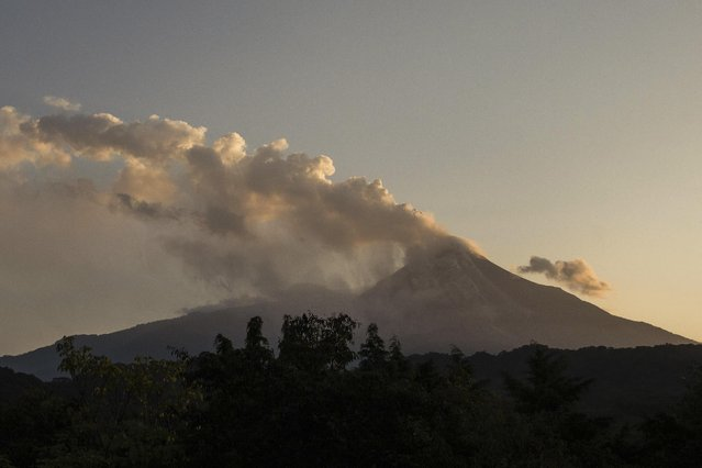 Smoke and ash rise from the Colima volcano, also known as the Volcano of Fire, near the town of Comala, Mexico, Friday, July 10, 2015. (Photo by Sergio Tapiro Velasco/AP Photo)