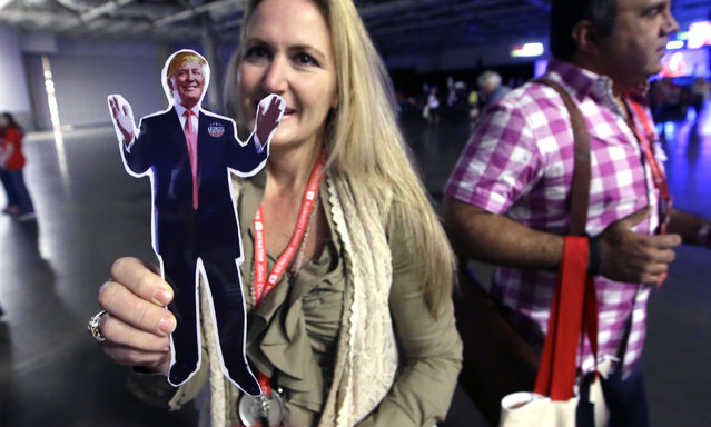 "Dallas County delegate Donna Warren Renteria, left, shows off her ""Flat POTUS Donald"", cutout during the Texas Republican Convention Thursday, May 12, 2016, in Dallas. (Photo by L.M. Otero/AP Photo)"