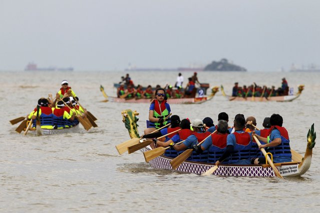 Participants get ready to compete in a race during the Chinese dragon boat festival in the outskirts of Panama City, July 12, 2015. The Panama's Chinese community celebrates for the first time the Dragon Boat festival. (Photo by Carlos Jasso/Reuters)