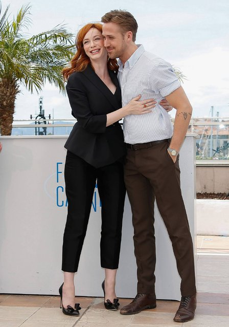 """Canadian actor and director Ryan Gosling (R) and US actress Christina Hendricks (L) pose during the photocall for """"Lost River"""" at the 67th annual Cannes Film Festival, in Cannes, France, 20 May 2014. The movie is presented in the section Un Certain Regard of the festival which runs from 14 to 25 May. (Photo by Julien Warnand/EPA)"""